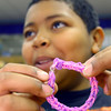 4-24-14   --- Sycamore Elementary 5th graders make bracelets to raise money for Relay for Life. Josiah Sears shows off the bracelet he just made. -- <br />   Tim Bath | Kokomo Tribune