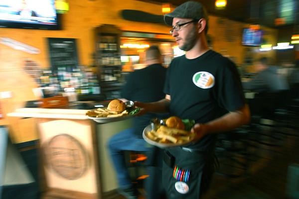 4-25-14   --- Smitty McMusselman's Pub & Grub in Peru at 202 South Broadway. Waiter Ian Watson delivering food to customers. -- <br />   Tim Bath | Kokomo Tribune