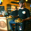 4-25-14   --- Smitty McMusselman's Pub & Grub in Peru at 202 South Broadway. Waiter Ian Watson delivering food to customers. -- <br />   Tim Bath | Kokomo Tribune