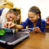 4-1-14   --- Exchange students from Finland at Central Middle School. Central Student Zara Hooper, exchange student Evie Mallender, Central Student Lauren Hicks and exchange student Jessica Bull work on a project during lab time in class. -- <br />   Tim Bath   Kokomo Tribune