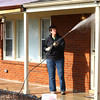 4-10-14<br /> Tornado cleanup over spring break<br /> Mary Neighbour power washes the front of a home on Cranbrook Drive in Kokomo on Thursday morning. Neighbour was in Kokomo along with others from Ward Church in Northville, Mich. to help clean up houses that were affected by November's tornado.<br /> Kelly Lafferty | Kokomo Tribune