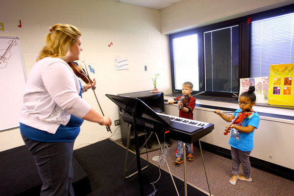 4-21-14   --- Wallace School of Integrated Arts teacher Keisha Cook teaching kids violin to kindergarteners. -- <br />   Tim Bath | Kokomo Tribune