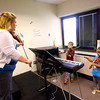 4-21-14   --- Wallace School of Integrated Arts teacher Keisha Cook teaching kids violin to kindergarteners. -- <br />   Tim Bath | Kokomo Tribune
