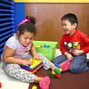 4-11-14<br /> Dream Makers day care<br /> Layla Mayfield and Andy Doan play with legos together at Dream Makers Day Care.<br /> Kelly Lafferty | Kokomo Tribune