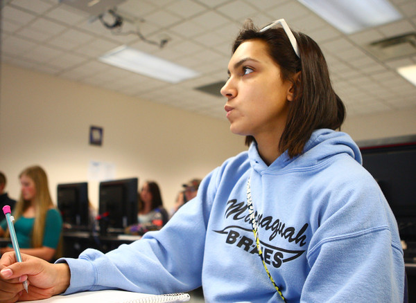 4-9-14<br /> First generation college student, Keeana Walton<br /> Keeana Walton takes notes in her English class at IUK.<br /> Kelly Lafferty | Kokomo Tribune
