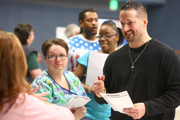4-9-14<br /> Aiming for Success-job fair which encourages candidates with felony records to attend<br /> Donnie Brown (right) and Aimee Mundy talk with some of the businesses at the Aiming for Success job fair at Mt. Pisgah Church.<br /> Kelly Lafferty | Kokomo Tribune