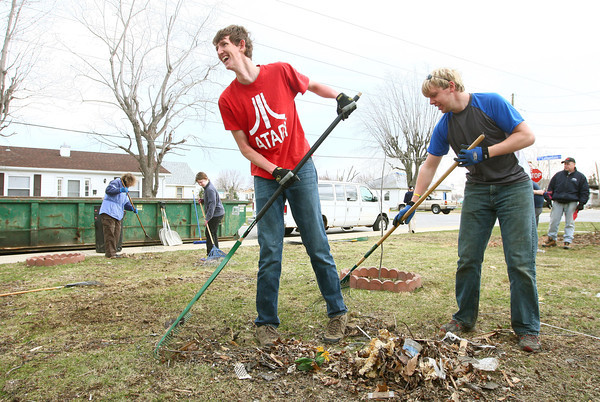 4-10-14<br /> Tornado cleanup over spring break<br /> Matthew Neighbour and Aaron Smith work together with others from Ward Church in Northville, Mich. to rake the front yard of a home on Poplar Street in Kokomo that was affected by the November tornado. The teenagers chose to volunteer during their Spring Break.<br /> Kelly Lafferty | Kokomo Tribune