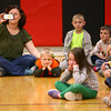 4-2-14   --- Taylor Primary School held a learning convocation to teach students what they can learn from the way Ryan Beining lived. Ryan's mom Anita and brother Zachary watch Ryan's old classmates act out different teaching scenarios. -- <br />   Tim Bath | Kokomo Tribune