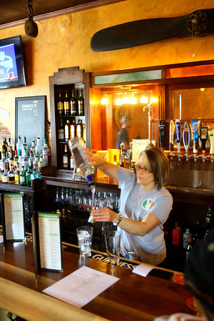 4-25-14   --- Smitty McMusselman's Pub & Grub in Peru at 202 South Broadway. Bartender Misty Baker pouring a drink.  -- <br />   Tim Bath | Kokomo Tribune