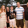 7-31-12<br /> 15-year-old Skyler Ramberger stands with members of the Lechner family after he received the Steve Lechner mental attitude award on Tuesday night.<br /> KT Photo | Kelly Lafferty