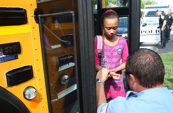 8-14-12<br /> Minor bus accident at Hoffer and Webster<br /> An Elwood Haynes Elementary student gets her wrist examined after a minor bus accident on Tuesday afternoon.<br /> KT photo | Kelly Lafferty