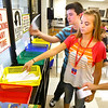 8-1-12<br /> Maconaqua First day of school - Maconaqua Middle School<br /> Eighth grade students Brayden Howard and Alli Workman turn in their assignment during science class.<br /> KT photo | Tim Bath