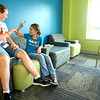 8-14-12<br /> Kokomo YMCA activities throughout the day. The YMCA is  looking at building a new facility on the old Button Motors site. Central Middle School students Grace Lefler and Emily Whiteman hanging out in the lobby before the after school activities begin. <br /> KT photo | Tim Bath