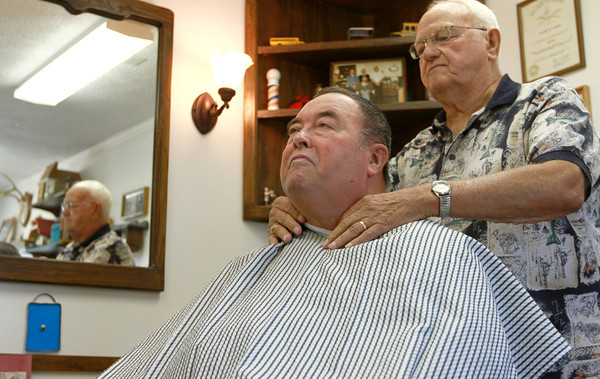 8-22-12<br /> Don's Barbershop<br /> Barber Don Wisher preps Mike Jackson for a haircut at Don's Barbershop.  Wisher says he has cut Jackson's hair for about 42 years.<br /> KT photo | Kelly Lafferty