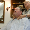 8-22-12<br /> Don's Barbershop<br /> Barber Don Wisher preps Mike Jackson for a haircut at Don's Barbershop.  Wisher says he has cut Jackson's hair for about 42 years.<br /> KT photo   Kelly Lafferty