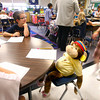 8-30-12<br /> Taylor Primary School 3rd graders carry a stuffed monkey around the school in place of classmate Alana Johnson who is out sick with Lukemia. Peyton Reed sits with Alana during a group math session.<br /> KT photo | Tim Bath