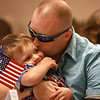 8-10-12<br /> Spc. Anthony Walton Fundraiser at the Grotto<br /> Spc. Anthony Walton kisses his 3-year-old son Noah on Thursday during the Homes for Wounded Warriors Program fundraiser.<br /> KT Photo | Kelly Lafferty
