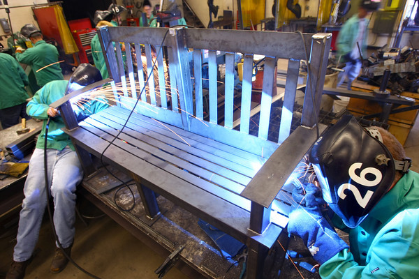 8-28-12<br /> Students Cody Damewood and Kyle Duke weld one of 10 benches that the welding class is making for the remodeled sports facilities at KHS. The benches will then be painted by the autobody class.<br /> KT photo   Tim Bath