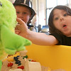 8-11-12<br /> Baby Expo at IUK<br /> Ashton Mollo, 4, feeds rice to a frog puppet during the Baby and Kids Expo at IUK on Saturday.<br /> KT Photo | Kelly Lafferty