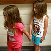 8-9-12<br /> First day of school for twins Mara and Keara Dechert<br /> Mara and Keara Dechert hold hands so they can be next to eachother in line to go into the classroom for violin lessons at Wallace on Thursday.<br /> KT photo | Kelly Lafferty