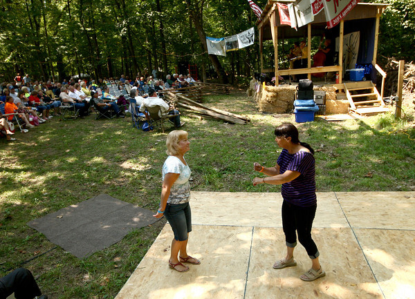 8-25-12<br /> Winding Creek bluegrass festival<br /> Mary Hardin (left) and Barbara Coley dance on the wooden dance floor next to the stage during one of the songs at the Winding Creek Bluegrass Festival on Saturday. <br /> KT photo | Kelly Lafferty