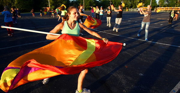 8-22-12<br /> Western HS marching band practices on Thursday morning. Marlis Feightner twirling her flag as part of the color guard.<br /> KT photo | Tim Bath