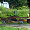 8-17-12<br /> Area in Deer Creek subdivision in Miami County that is thought to be an old pioneer cemetery. The house that stood on the property burned down. Now a septic system is being installed to build a new house.<br /> KT photo | Tim Bath