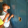 8-1-12<br /> Maconaqua First day of school - Maconaqua Middle School<br /> Teacher Elizabeth Resler helps 6th grader Mason Queen open his locker for the first time.<br /> KT photo | Tim Bath