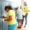 8-1-12<br /> Maconaqua First day of school - Maconaqua Middle School<br /> Erica Dilworth opening her locker. Teacher Elizabeth Resler helps 6th grader Mason Queen open his locker for the first time.<br /> KT photo | Tim Bath