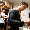 8-10-12<br /> International Dorm<br /> 16-year-old Miguel Chahin Buganza puts ketchup on his hot dog in the kitchen of the international dorm for dinner as Keita Komatsuzaki and Oscar Gandara Hernandez wait in line for food.<br /> KT Photo | Kelly Lafferty