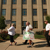 8-30-12<br /> Delphi rally<br /> Delphi salaried retirees walk around the courthouse square on Thursday carrying signs during a rally to protest their reduced pensions.<br /> KT photo | Kelly Lafferty