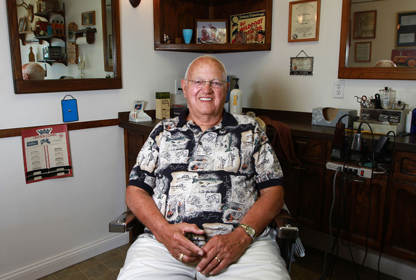 """8-22-12<br /> Don's Barbershop<br /> """"I never dreaded coming to work,"""" said 73-year-old barber, Don Wisher. """"I couldn't wait to wake up in the morning and open the door."""" Wisher has been a barber for 52 years.<br /> KT photo 