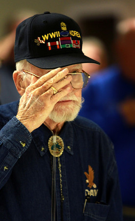 8-10-12<br /> Spc. Anthony Walton Fundraiser at the Grotto<br /> World War II, Vietnam, and Korea War veteran Arnold Wallace salutes the flag during the National Anthem at the IBN Saud Grotto on Friday night.<br /> KT Photo | Kelly Lafferty