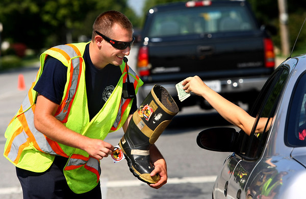8-15-12<br /> Stewart Matlock collecting money for the Kokomo Fire Departments Fill the Boot campaign for MDA. He is at the corner of Webster Street and Lincoln Road. KFD will be at various points throughout Kokomo on Friday and Saturday too.<br /> KT photo | Tim Bath