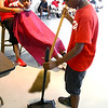 8-6-12<br /> Back to school haircuts provided free of charge at Carver Community Center by Kut Above and MC Barber Shop. David Stokes, 10, cleaning up the hair that was cut from his head.<br /> KT photo | Tim Bath