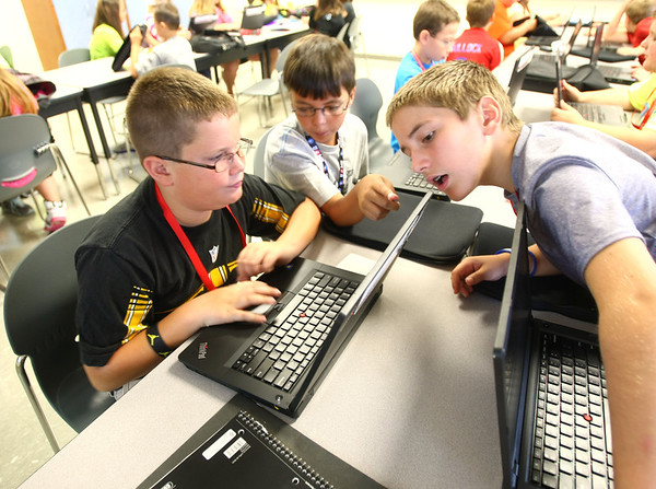 8-1-12<br /> Maconaqua First day of school - Maconaqua Middle School<br /> Sixth grade students Mason Cowan, Christian Newman and Chase Williams check out the laptops they were issued at Maconaqua MS.<br /> KT photo | Tim Bath