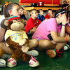 8-30-12<br /> Taylor Primary School 3rd graders carry a stuffed monkey around the school in place of classmate Alana Johnson who is out sick with Lukemia. Shaylan Martin was assigned to take Alana around for the afternoon. They are sitting in reading class after recess.<br /> KT photo | Tim Bath