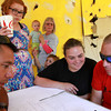 8-17-12 and 8-18-12<br /> Wounded Warrior house destruction<br /> From left, Markus Trouerbach, Grace Walton, Lily Walton, Kathy Morrison, Noah Walton, Rhonda Walton, and Anthony Walton look over the design plans for the new Walton family home in the remains of the old living room.<br /> KT photo | Kelly Lafferty