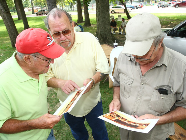 8-4-12<br /> Employees of the now defunct Continental Steel gather for a bi-annual reunion at Highland Park's Roger's Pavilion. While looking at an old photographe taken at the plant in the 1970s  Richard McAninch, Larry Nichols and Willis Dennis talk about the days at the steel mill.<br /> KT photo | Tim Bath