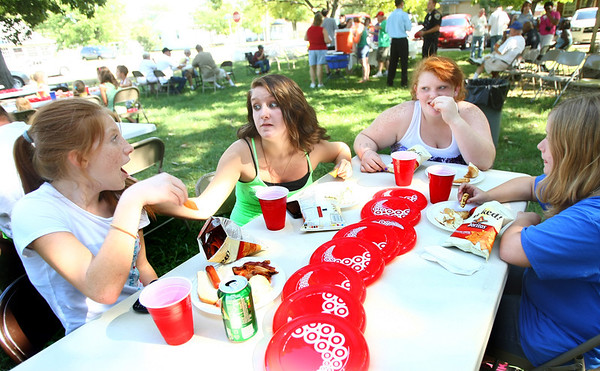 8-7-12<br /> National Night Out at Bon Air Park from 5 till 7 p.m. Hot dogs and sides were served with Kokomo Police Officers in attendence. Sarah Kimbell, 15, Stephanie Crabtree, 16, Alysha Eilers, 14, and Emily Crabtree, 14, joking around while they eat.<br /> KT photo | Tim Bath