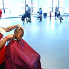 8-6-12<br /> Back to school haircuts provided free of charge at Carver Community Center by Kut Above and MC Barber Shop. Jedaiah Beard, 5, getting a hair cut from Joyce Coleman from MC Barber Shop.<br /> KT photo | Tim Bath