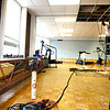8-14-12<br /> Kokomo YMCA activities throughout the day. The YMCA is  looking at building a new facility on the old Button Motors site. Steve Dunn from Stevens Machine fabrication division installing TRX extreme exercise equipment.<br /> KT photo | Tim Bath