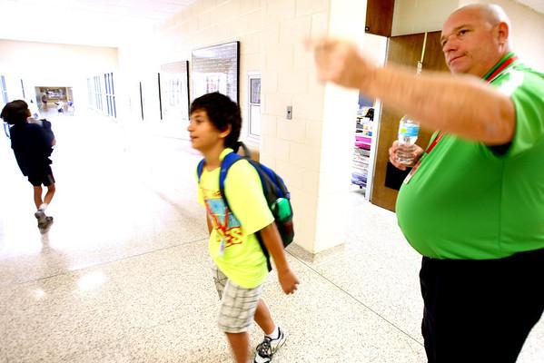 8-1-12<br /> Maconaqua First day of school - Maconaqua Middle School<br /> Tim Wittenberg directs kids between class.<br /> KT photo | Tim Bath