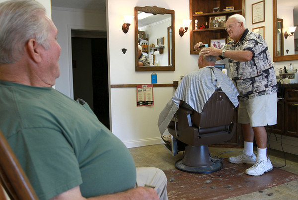 8-22-12<br /> Don's Barbershop<br /> 73-year-old Don Wisher cuts hair while his friend Jim Meiring, left, stops in for a visit. Wisher has been barbering for 52 years. <br /> KT photo | Kelly Lafferty
