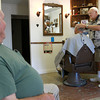 8-22-12<br /> Don's Barbershop<br /> 73-year-old Don Wisher cuts hair while his friend Jim Meiring, left, stops in for a visit. Wisher has been barbering for 52 years. <br /> KT photo   Kelly Lafferty