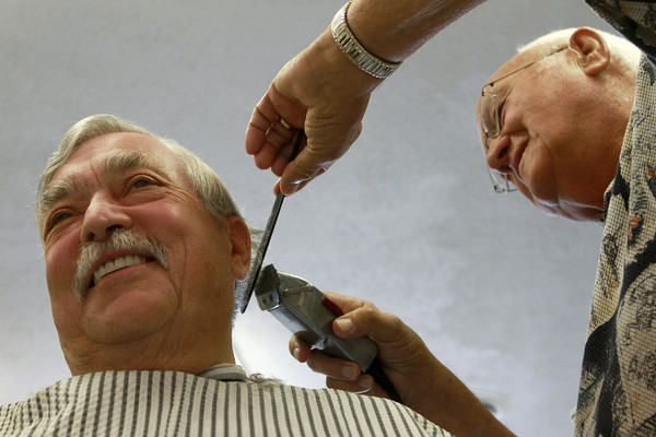8-22-12<br /> Don's Barbershop<br /> Steve Danforth catches up with Don Wisher as Wisher trims his hair at his barbershop. Wisher moved his barbershop to his home about eight years ago after having a shop in Greentown since 1966.<br /> KT photo | Kelly Lafferty
