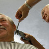 8-22-12<br /> Don's Barbershop<br /> Steve Danforth catches up with Don Wisher as Wisher trims his hair at his barbershop. Wisher moved his barbershop to his home about eight years ago after having a shop in Greentown since 1966.<br /> KT photo   Kelly Lafferty