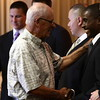 8-8-12<br /> Kokomo Police Department Officer Recruitment Ceremony<br /> Retired policeman Bob Beeler shakes the hand of Brandon O. Hector during the recruit officer ceremony on Wednesday.<br /> KT photo | Kelly Lafferty
