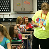 8-1-12<br /> Maconaqua First day of school - Maconaqua Middle School<br /> Science teacher Marsha Piggott hands out assignments to the kids.<br /> KT photo | Tim Bath