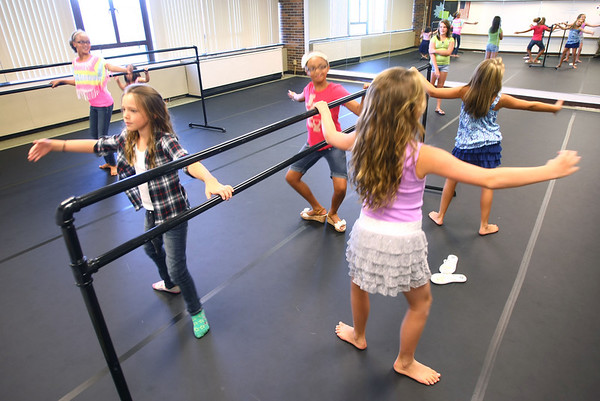 8-6-12<br /> Open house held at Wallace Integrated Art School<br /> Students participate in a demonstration in the dance room. Jillian Shumaker, 10, is in plad.<br /> KT photo | Tim Bath